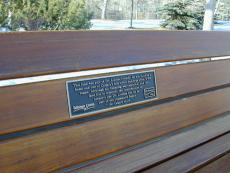 A Plaque On a Park Bench
