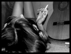 Girl behind the guitar.