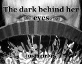 The dark behind her eyes