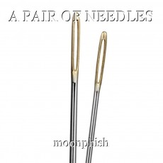 A PAIR OF NEEDLES