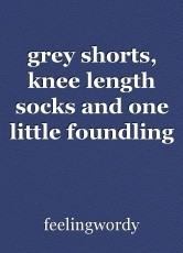 grey shorts, knee length socks and one little foundling boy
