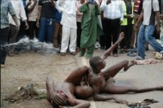 ALLEGED GAY EDEWI OSARIEMEN ISRAEL ESCAPED IN A VILLAGE SHRINE IN BENIN CITY EDO STATE. 26 MAY, 2014