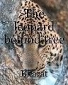 The leopard behind tree